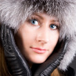 Young woman in big fur cap — Foto de Stock