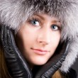 Young woman in big fur cap — Stock Photo