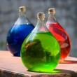 Three vesseles with colored liquid — Stock Photo
