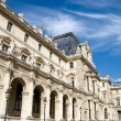 Louvre building in Paris - Stock Photo