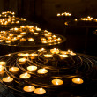 Many candles in old temple - Stock Photo