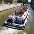 Tourist boat in Paris - Stock Photo