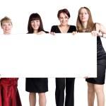 cuatro mujeres sosteniendo carteles en blanco blanco — Foto de Stock