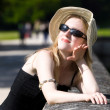 Young woman in hat enjoy the sun - Stock Photo