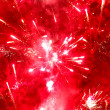 Bright red firework - Stock Photo