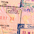 stamps in foreign passport closeup — Stock Photo