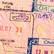 Stamps in foreign passport closeup — Foto Stock