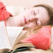 Young slipping woman with book — Stock Photo #1730792