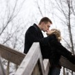 Kiss on a bridge — Stock Photo