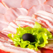 Tasty ham with lettuce and olive — Stock Photo
