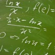 Math formulas on school blackboard — Stock Photo