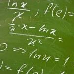 Math formulas on school blackboard — Stock Photo #1730895