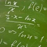 Math formulas on school blackboard — Stock Photo