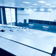 Big physics lecture hall blue tint — Stock Photo