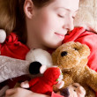 Young tender girl sleeping with her toys — Stock Photo #1730955