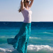 Slim woman enjoy warm sea wind — Stock Photo #1730975