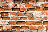 Very old and damaged brick wall — Stock Photo