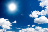 Dramatic high contrast blue sky with sun — Stock Photo