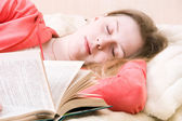 Young slipping woman with book — Stock Photo
