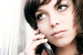 Businesswoman speaking on mobile phone — Stock Photo