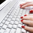 Woman typing on laptop keyboard — Foto de Stock