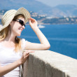Young woman in hat looking at the sea — Stock Photo #1751880