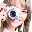 Young woman with digital camera — Stock Photo