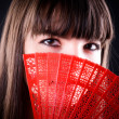 Woman with fan portrait — Stock Photo