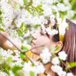 Young woman smelling flowers — Stock Photo