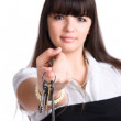 Businesswoman stretching keys — Stock Photo