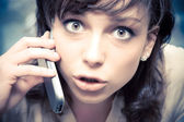 Young emotional woman with mobile phone — Stock Photo