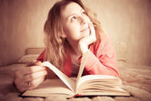 Girl dreams reading the book — Stock Photo