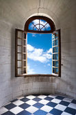 Old wide open window in castle — Stockfoto