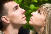 Young couple lookin up — Stock Photo