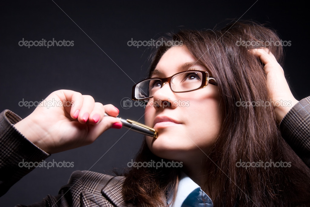 Thoughtful businesswoman portrait. On dark background. — Stock Photo #1752105