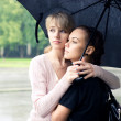 Two girls under umbrella — Stock Photo #1801177