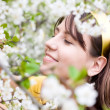 Young woman with spring cherry flowers — Stock Photo