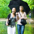 Two girls rejoice to rainy weather - Stock Photo