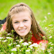 Stock Photo: Young woman in high green grass