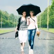 Two women in a heavy rain — Stock Photo