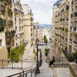 Common French street with buildings - Stock Photo
