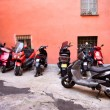 Italian narrow street with motor bikes - Stock Photo