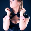 Young woman with pink handcuffs - Stock Photo