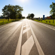 Road with bright sun - Stock Photo