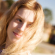 Young woman with fluttering hair — Stock Photo