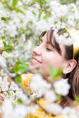 Young woman with spring cherry flowers — Stok fotoğraf