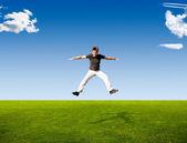 Happy jumping man — Stock Photo