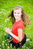 Young woman in a meadow — Stock Photo