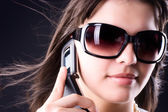 Woman in sunglasses with mobile phone — Stock Photo