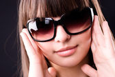 Young woman in sunglasses portrait — Stock Photo